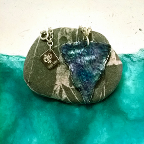 Textile resin free form pendant in a peacock blue, green, purple colour mix