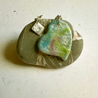 Wool textile resin pendant in a green blue lavender colour mix