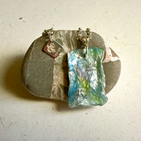 Wool textile resin pendant in a blue green lavender colour mix