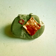 Wool textile resin pendant in a orange colour mix