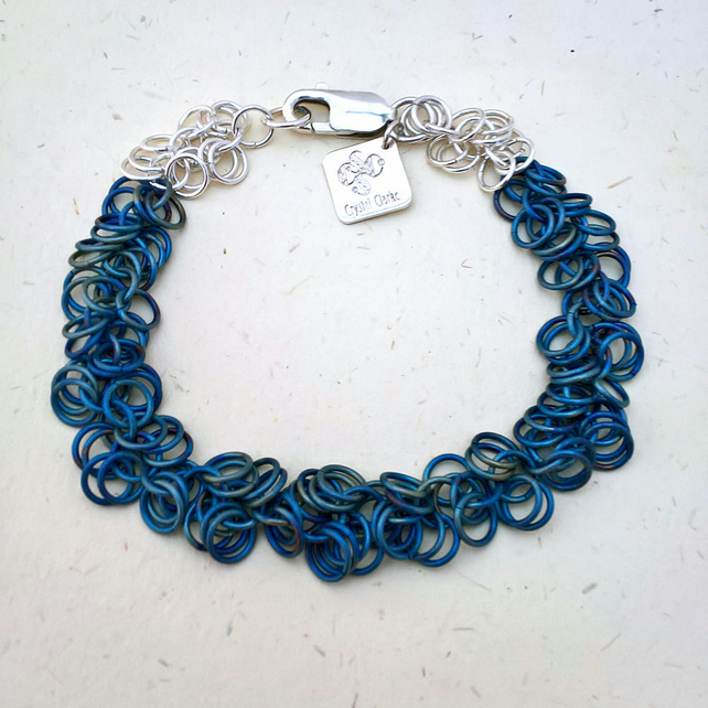 Shaggy loops by Crystal Clarke - textile collection of hand woven titanium links