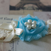 NURIA: Sky Blue Wedding Garter. Pearl Flower Button