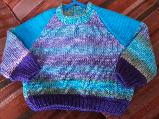 Sky blue patterned hand knitted baby jumper