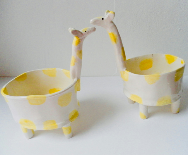 A PAIR OF GIRAFFE PLANTERS HIM AND HER