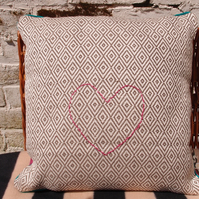Handmade cushion with heart design. Geometric pattern. Contemporary decor