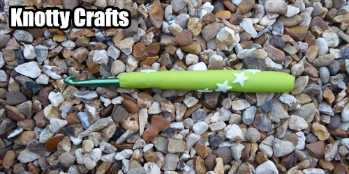 Crochet Hook Size 6 mm Lime Clay with GLOW IN DARK STARS around handle.