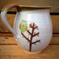 Pottery mug woodland owl stitting in a tree