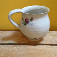 Pottery stoneware handthrown cup mug white with multiple thistle