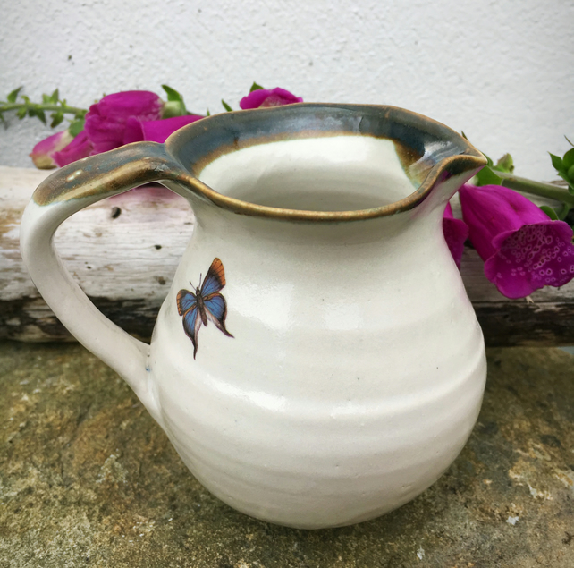 Pottery ceramic stoneware jug with butterfly
