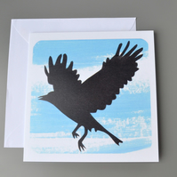 SALE - Silhouette of bird in flight card with painted blue background