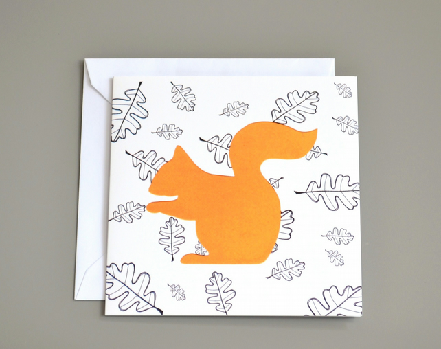 Squirrel in front of black and white leaf pattern blank card.