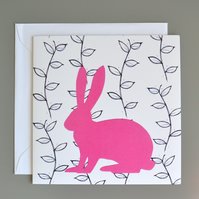 Hare in front of black and white leaf pattern blank card.