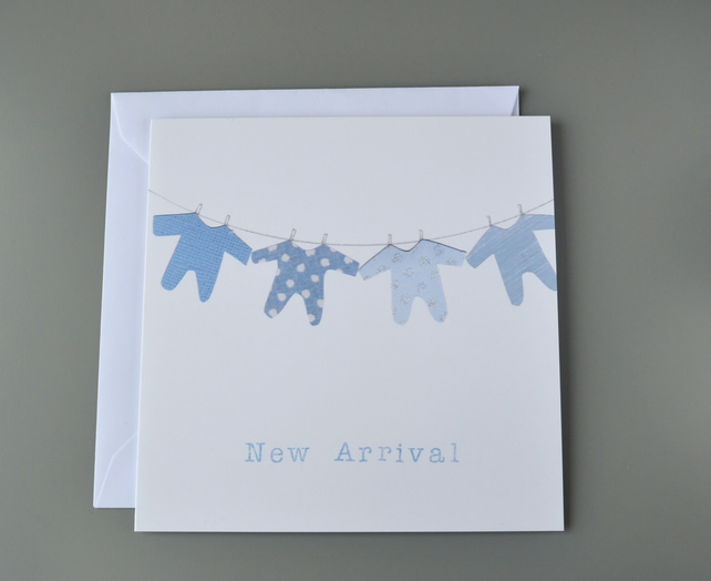 New Baby Boy 'New Arrival' Card with washing line of blue babygros