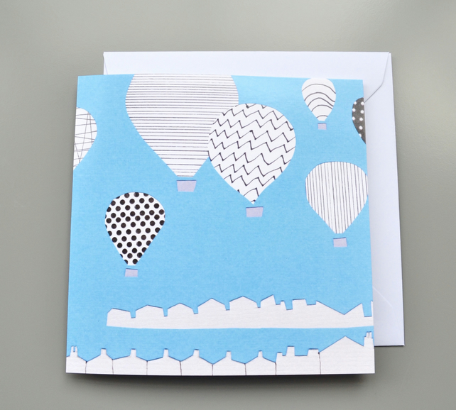 Monochrome Hot Air Balloons on Blue Background