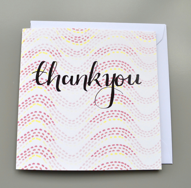 Hand Lettered Thank You Card on Orange Toned Patterned Background