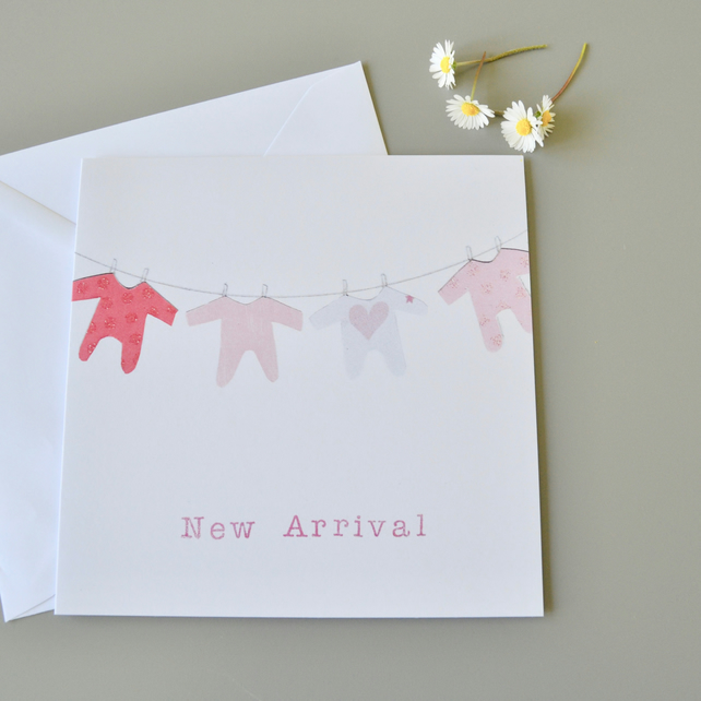 New Baby Girl 'New Arrival' Card with washing line of pink babygros