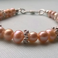 Peach cultured pearl bracelet