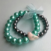 Turquoise and grey glass pearl bird bracelet