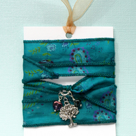 Teal patterned silk wrap bracelet with tree charm