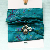 Teal silk wrap bracelet with ladybird charm