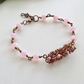 Knotty wire and pink crystal bracelet