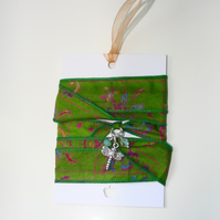 Green patterned silk ribbon wrap bracelet with dragonfly charm