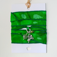 Bright green silk ribbon wrap bracelet with Pegasus charm