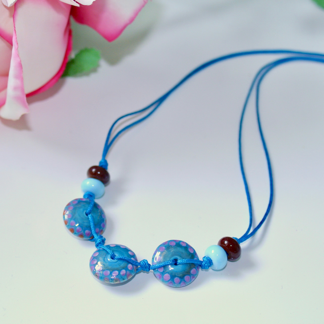 Blue lampwork glass disc and cord necklace