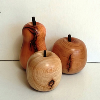 Three Wood turned fruits 361