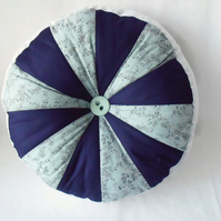 "large plump pinwheel round scatter cushion, mint and navy, 13"" diameter"