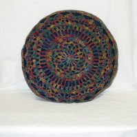 multicoloured crocheted mandala scatter cushion, big circular blue throw pillow
