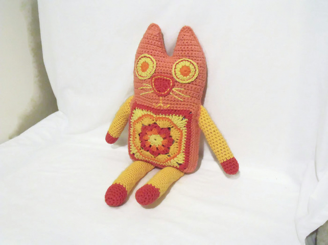 large peach crocheted granny square rag doll amigurumi cat