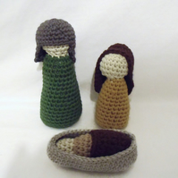 crocheted nativity scene of mary, joseph and baby jesus, christmas display