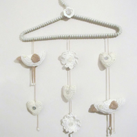 crochet bird, flowers and hearts hanging wall decorations in neutral shades