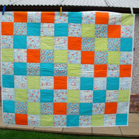 upcycled patchwork quilt in vibrant colours, wheelchair blanket