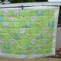 unisex green patchwork nursery quilt, cot blanket with owls or play mat