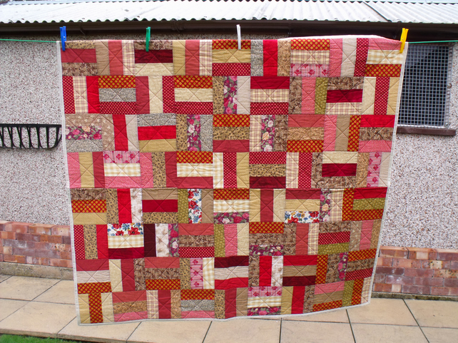 rail fence patchwork quilt in autumnal colours, quilted sofa throw