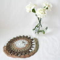 neutral coloured crocheted doily, crocheted mandala using variegated yarn