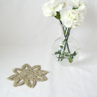 silver coloured delicate crocheted floral embellishment to add to a project
