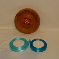 two rolls of 15mm satin ribbon, 25 metres on each, coordinating turquoise trim