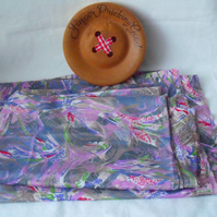 two unused remnants of polyester abstract dressmaking fabric, two pieces 30 x 44