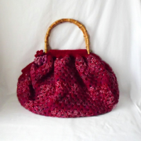 one of a kind lined crocheted granny bag with bamboo handles in maroon.