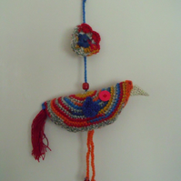 bright colourful crocheted hanging bird decoration for your wall or twig tree