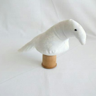 novelty bird ornament or bird pin cushion on a vintage wooden bobbin, white