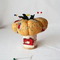 novelty pumpkin pin cushion on a vintage wooden bobbin
