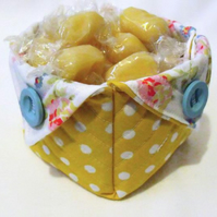 yellow folded fabric storage tub for your bits and bobs