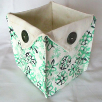 folded fabric storage tub for your bits and bobs, green and white