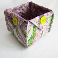 folded fabric storage tub for your bits and bobs, green and lilac