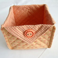 folded fabric storage tub for your bits and bobs, peach