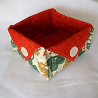folded fabric storage tub for your bits and bobs, leaf print fabric, rust red